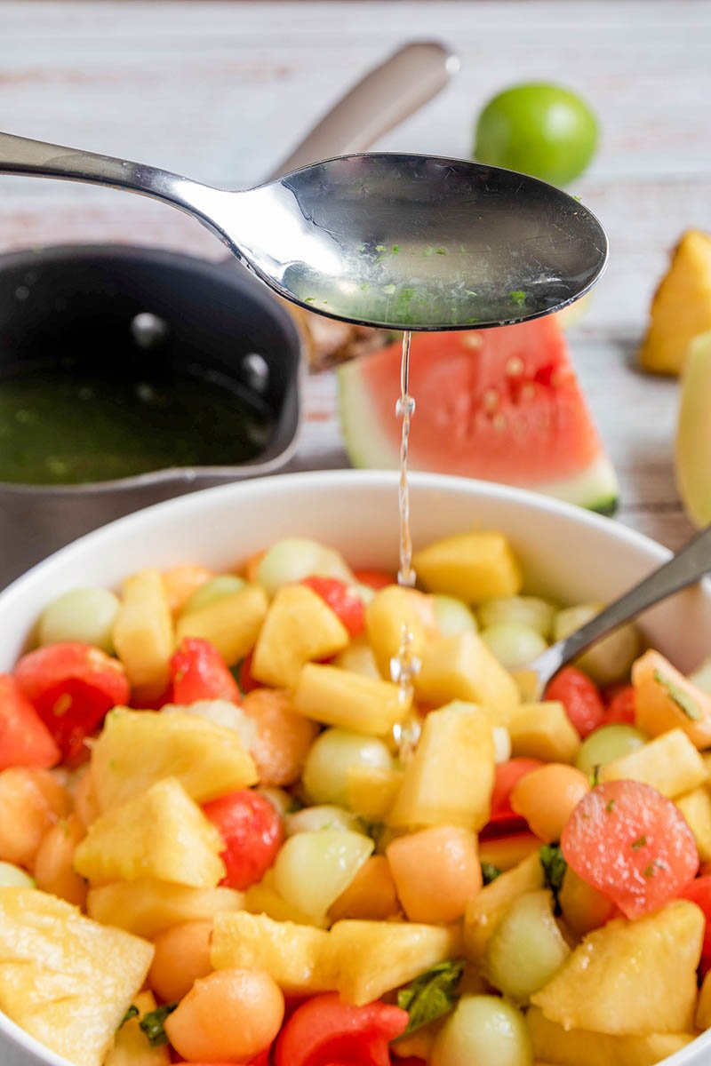 add syrup to melon balls
