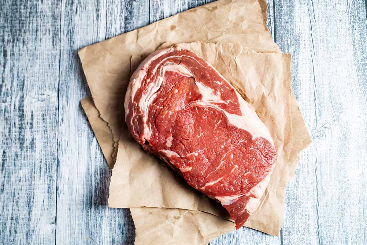 raw ribeye steak ready for the grill