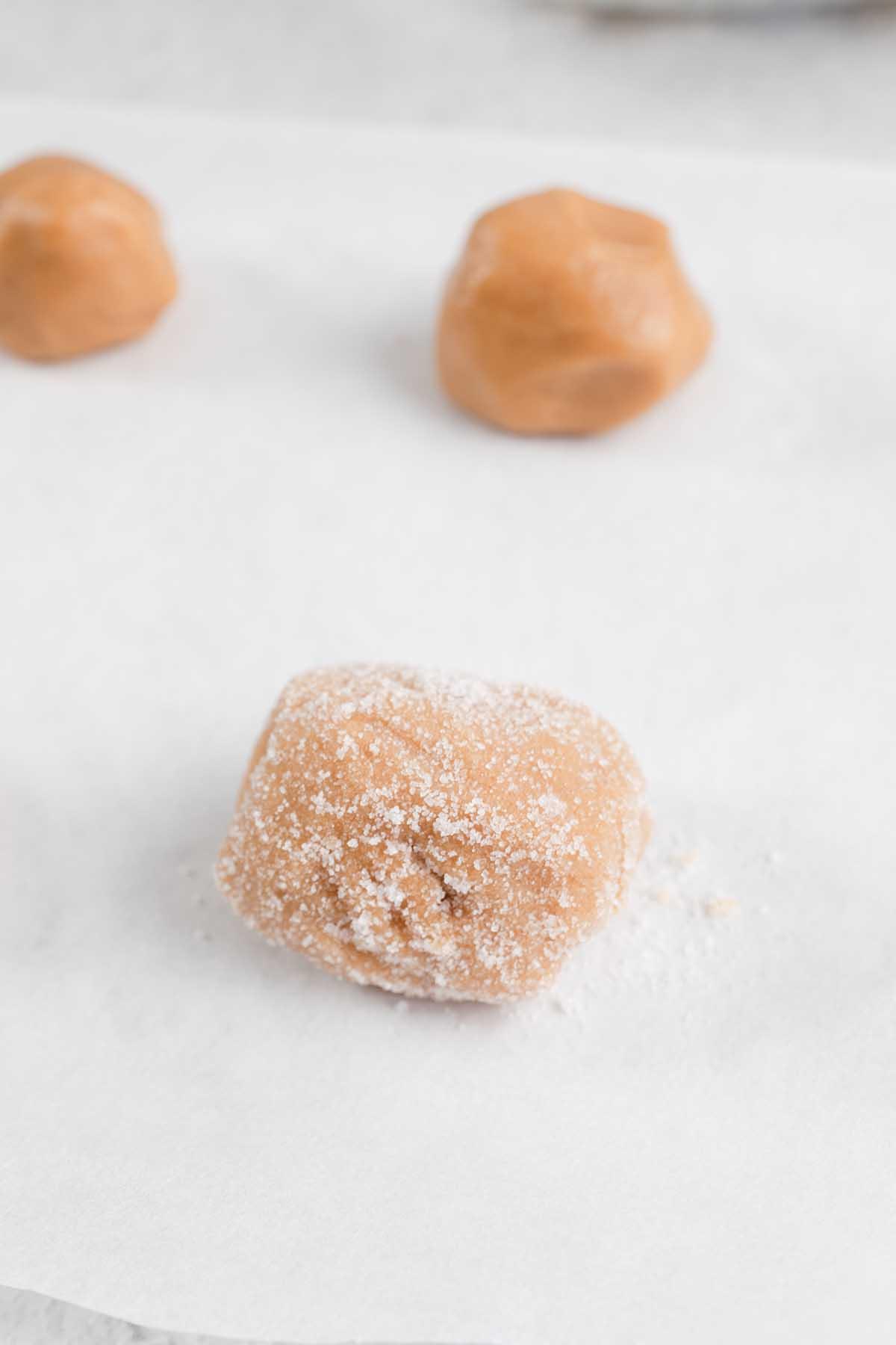 roll cookie dough balls into sugar